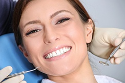 patient smiling in the dental chair