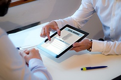 dentist showing dental insurance forms on a tablet
