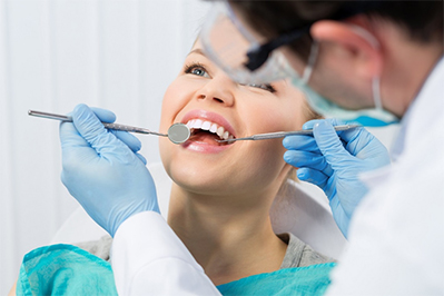 Woman receiving restorative dentistry services