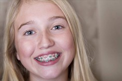 A young girl with braces